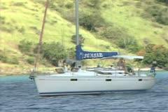 Close up of sailing boat moving along coast Stock Footage