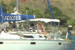 Woman on moving sailing boat Stock Footage