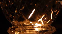Candle light through cut glass Stock Footage