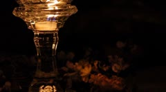 Candle over flower wreath Stock Footage