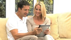 Modern Wireless Tablet Being Used by Caucasian Couple Stock Footage