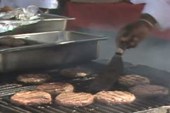 Close up of cooking burgers Stock Footage