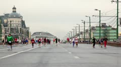 People run on Big Moskvoretsky bridge in XXX Moscow International Peace Marathon Stock Footage