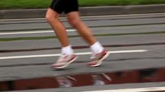 Man naked legs run in jogging shoes on asphalt Stock Footage