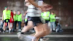 People run in both directions, some stop at recreation zone among humans Stock Footage
