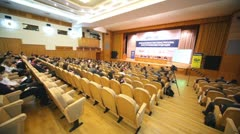 People sit in audience chamber at first annual Financial Forum Stock Footage
