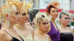 Stock Video Footage of Five models with fanciful hairdo at XVII International Festival World of Beauty