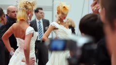 Spectators and judges look on models with fanciful hairstyle Stock Footage
