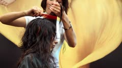 Hairdresser in action at XVII International Festival World of Beauty 2010 Stock Footage