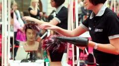 Girl dry mannequin hair at XVII International Festival World of Beauty 2010 Stock Footage