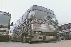 Reversing tour coach in carpark Stock Footage