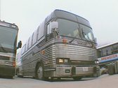 Stock Video Footage of Reversing tour coach in carpark