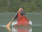 Stock Video Footage of Frontal view of man paddling kayak