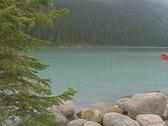 Stock Video Footage of Man paddling kayak across lake
