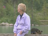 Stock Video Footage of Woman and pet dog sitting by lake
