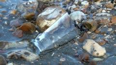 Broken Bottle Top on a Beach Stock Footage