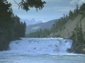 Stock Video Footage of Foaming rapids in wide river