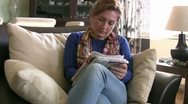 Women solving crossword puzzle Stock Footage