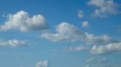 Fluffy White Clouds and Blue Sky Stock Footage