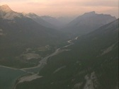 Stock Video Footage of Helicopter view of forested mountains and river