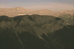 Helicopter view of forested mountains and river - stock footage