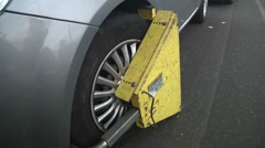 Clamped car wheel in Catania, Italy. Parking offence punished. - stock footage
