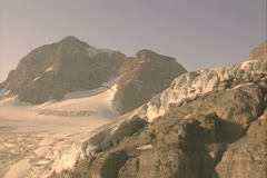 Aerial view of snowy mountain peaks - stock footage