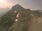 Aerial view over mountain peak Stock Footage
