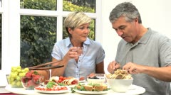 Middle Aged Couple Preparing Healthy Lunch Stock Footage