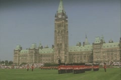 Stock Video Footage of Wide shot of guards standing to attention on lawn