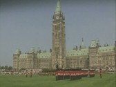 Wide shot of guards standing to attention on lawn Stock Footage
