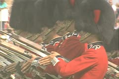 Close up of guards holding guns Stock Footage