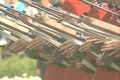 Close up of guards holding guns while music plays Stock Footage