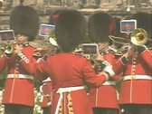 Guards playing music with conductor and walking flag bearers Stock Footage