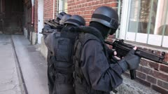 Special Forces securing door outside Stock Footage