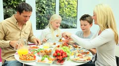 Attractive Young  Family Enjoying a Healthy Meal Stock Footage