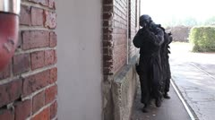 Special Forces securing door outside v2 Stock Footage
