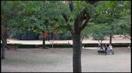 Jogging at park (pan shot) Stock Footage