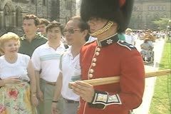 Tourists posing next to a Queen's Guard Stock Footage