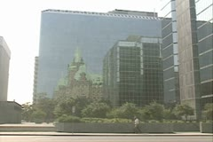 Reflection of traditional building in mirrored office block Stock Footage