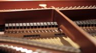 Stock Video Footage of Inside of a grand piano (strings & hammers)