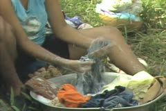 Woman handwashing clothes Stock Footage