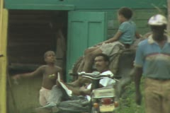 Man and children sitting outside Stock Footage