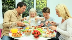 Young Caucasian Family Eating Healthy Lunch Together - stock footage