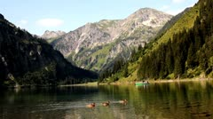 Mountain lake rowers Stock Footage