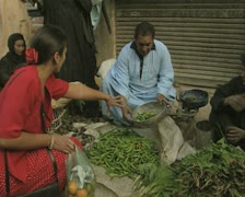 Man selling green chilis on street Stock Footage