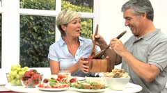 Middle Aged Couple Sharing Healthy Lunch Stock Footage