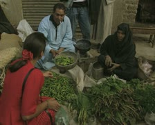 Man selling green chilis on street - stock footage