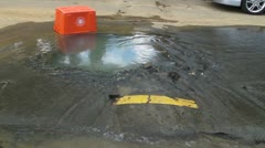 Broken street water main wasted water 1 Stock Footage