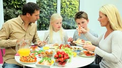 Attractive Caucasian Family Eating Together Stock Footage